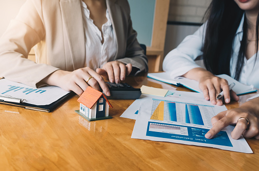 938640610 istock photo Real Estate Agent presenting and consult to customer to decision making sign insurance form agreement, concerning mortgage loan offer for and house insurance. 1085669804
