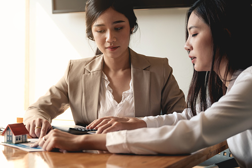 938640610 istock photo Real Estate Agent presenting and consult to customer to decision making sign insurance form agreement, concerning mortgage loan offer for and house insurance. 1130832270