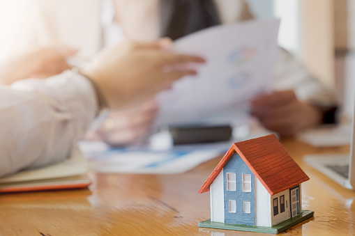 938640610 istock photo Real Estate Agent presenting and consult to customer to decision making sign insurance form agreement, concerning mortgage loan offer for and house insurance. 1168092626