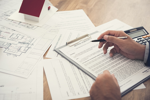 626187670 istock photo Real estate agent reviewing rental agreement 1136917692