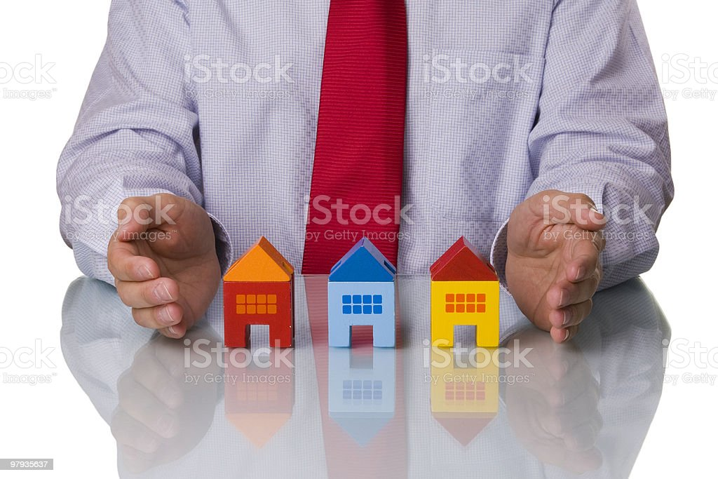 Real estate agent showing houses royalty-free stock photo