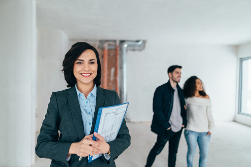 Real estate agent smiling to the camera
