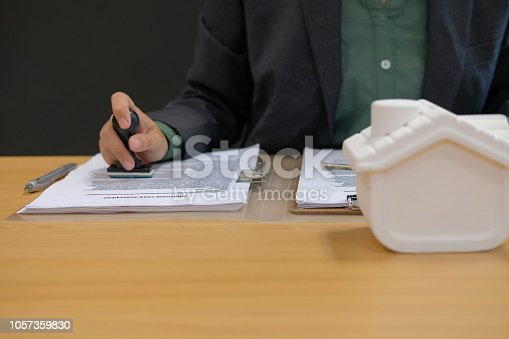 istock real estate agent stamping approved on mortgage loan contract agreement document 1057359830