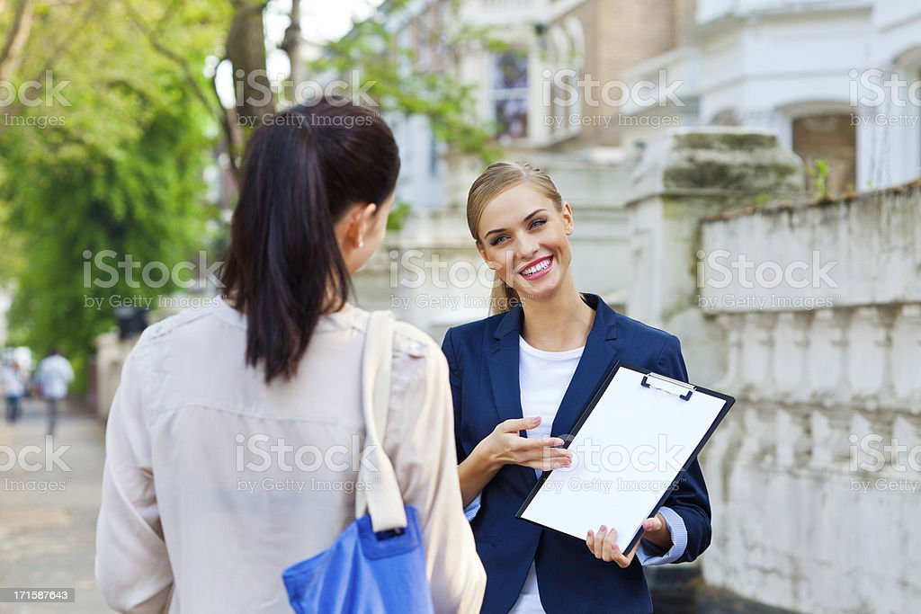 Real Estate Agent talking with client royalty-free stock photo