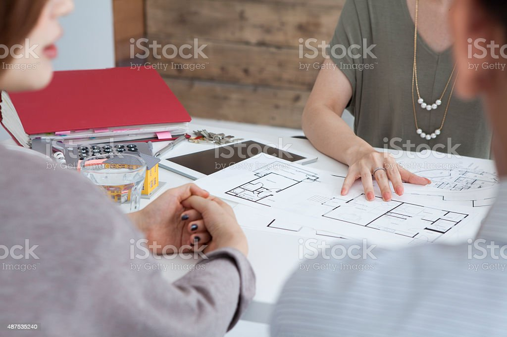 Real estate agent to explain a couple stock photo