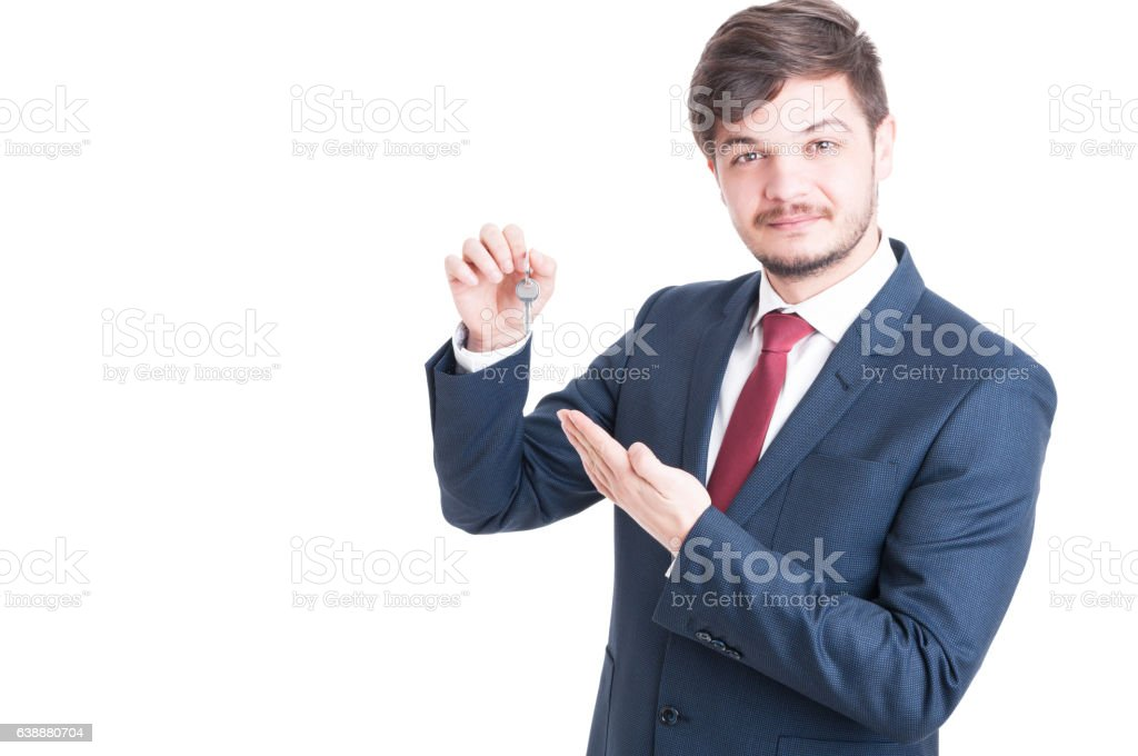 Real estate agent wearing suit showing keying stock photo
