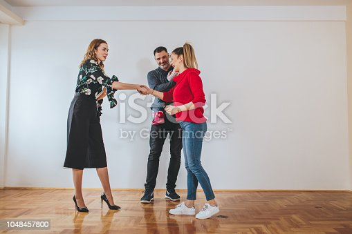 Lovely married couple with child, looking to buy a new apartment with a help of a real estate agent.