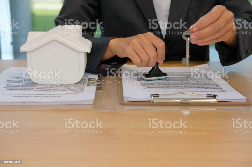 Real Estate Agent With House Key Stamping Approved On