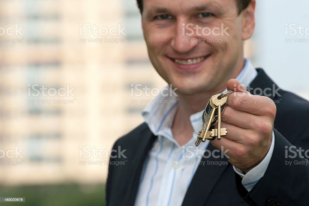 real estate agent with keys of a new house stock photo