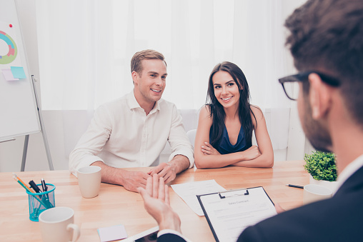 938640610 istock photo Real estate agent working with couple of customers in the office 947134338