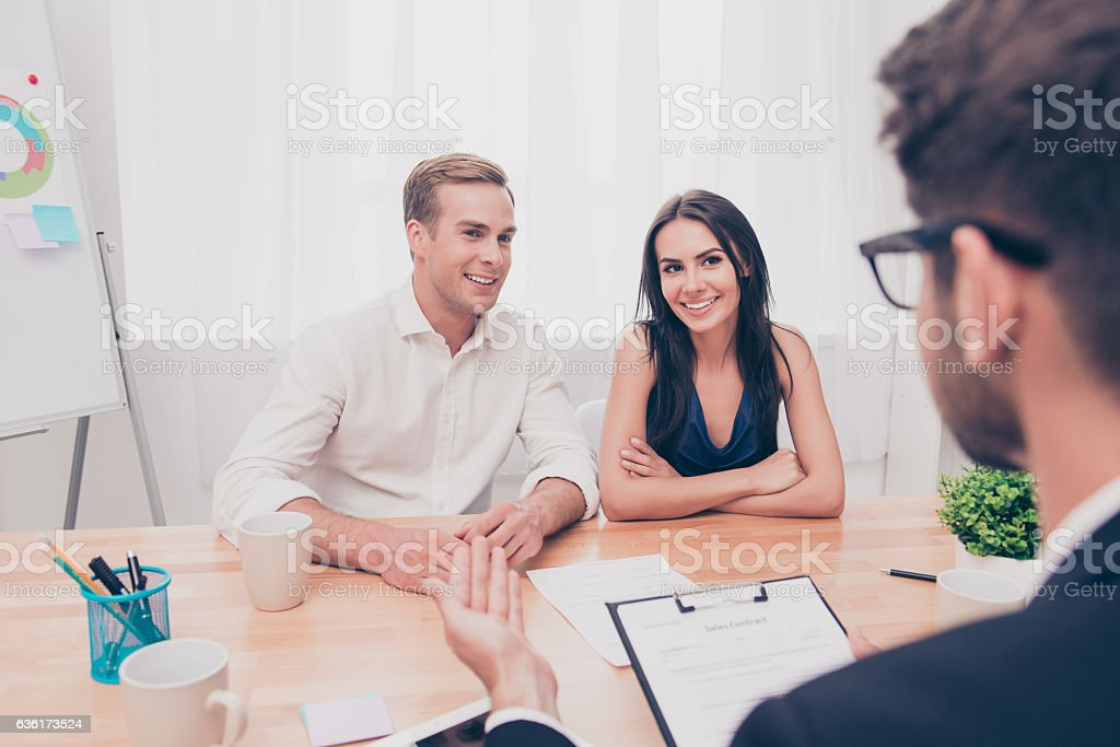 Real estate agent working with customers in the office stock photo