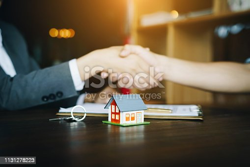 istock Real estate agents agree and customer shaking hands after signing contract documents for realty purchase.Concept mortgage loan approvalม home loan and insurance concept 1131278223