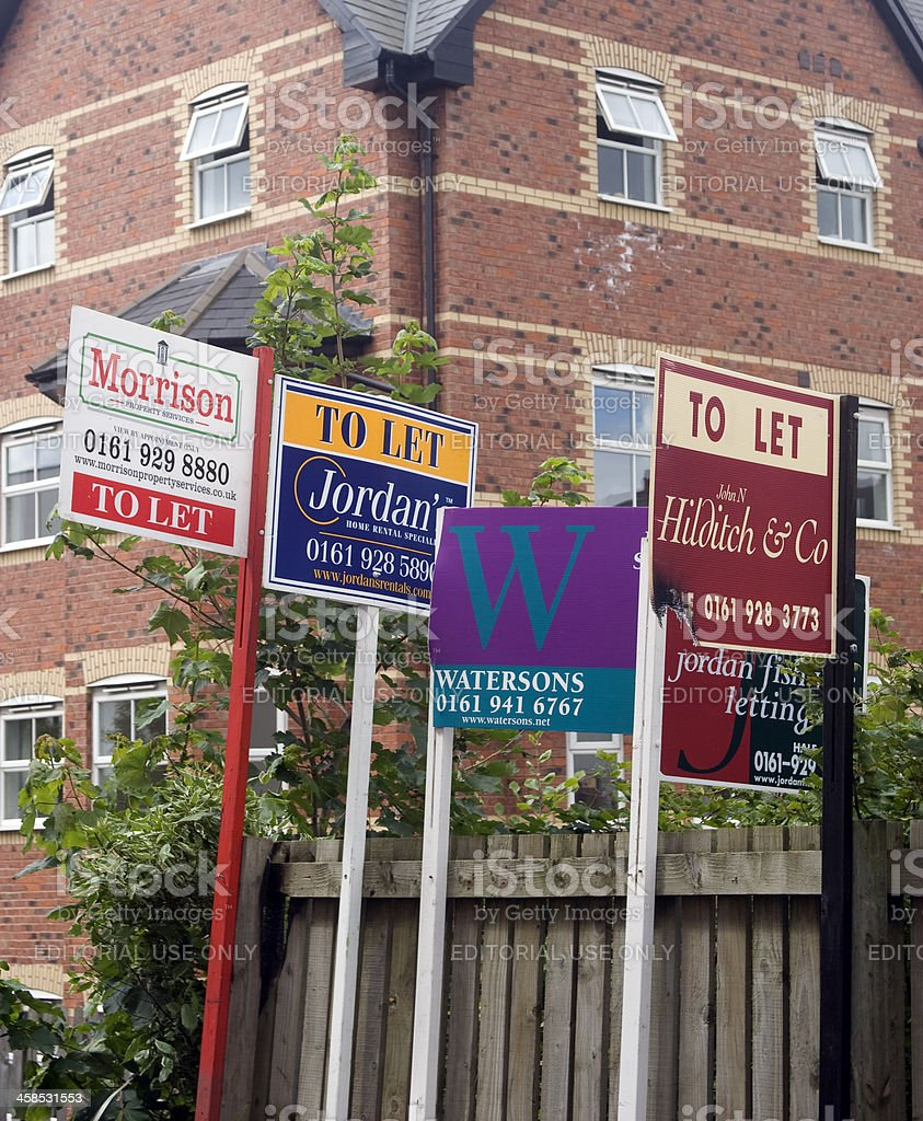 Real estate agents boards - signs of the times royalty-free stock photo