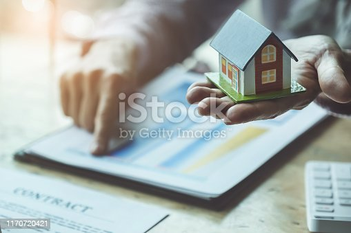 481337750istockphoto Real estate agents discussing about loans and interest rates for buying houses for customers who come to contact. contract and agreement concepts. 1170720421