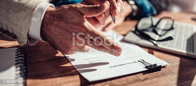 1072035844istockphoto Real estate agents pointing to rental contract 1132330769