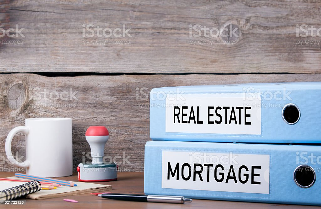 Real Estate and Mortgage. Two binders on desk i stock photo