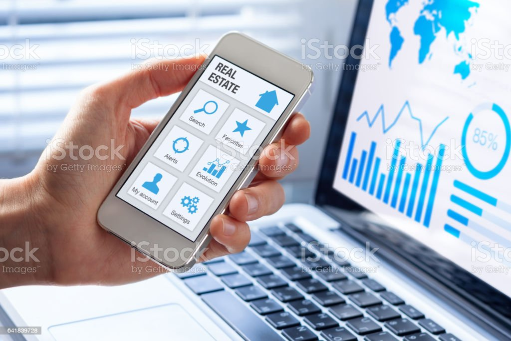 Real estate app concept on smartphone screen, person searching online stock photo