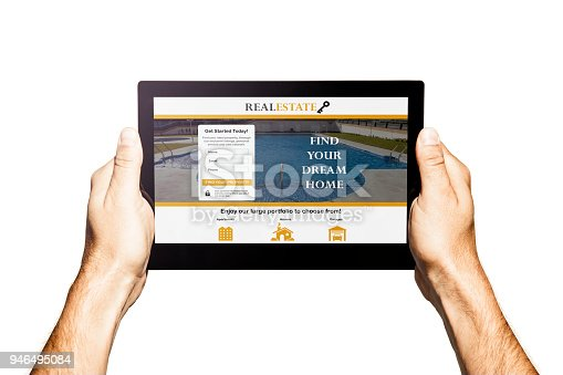 istock Real estate app in a tablet. Hands holding tablet. White background. 946495084