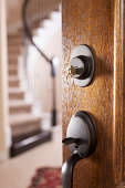 istock Real Estate, Architecture: Open door to modern home. House key. 464175543