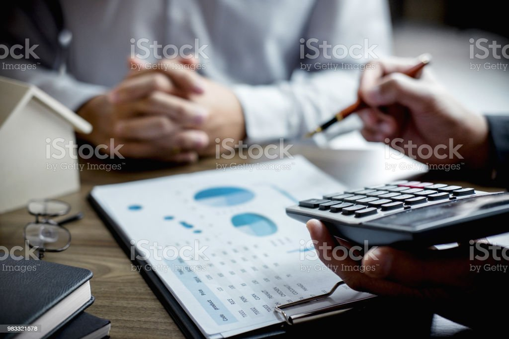 Real estate broker agent being analysis and making the decision a...