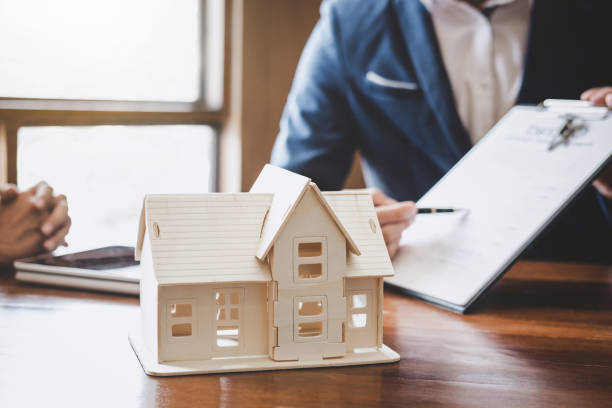 real estate broker agent presenting and consult to customer to decision making sign insurance form agreement, home model, concerning mortgage loan offer for and house insurance - real estate law stock photos and pictures
