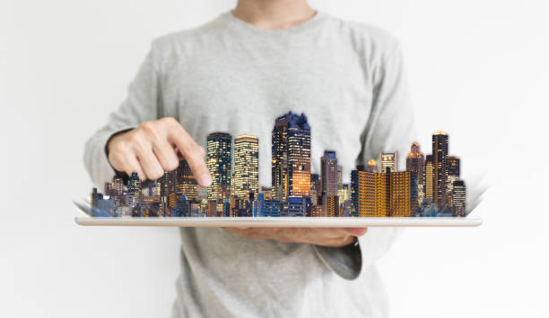 Real estate business and investment, building technology. a man using digital tablet with modern buildings hologram stock photo