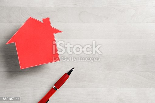 istock Real estate business. House for sale. Cottage made from cardboard paper on wooden table. House warming party template. Selling and buying home. Empty blank negative copy space. 832187144