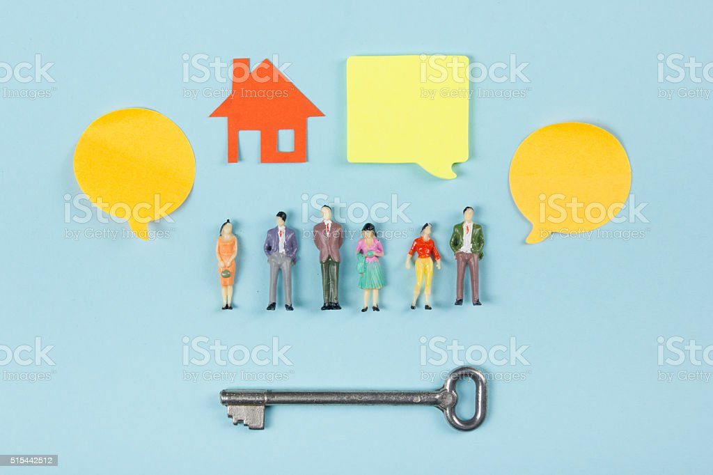 Real Estate concept. Blank speech bubbles and people toy figures stock photo