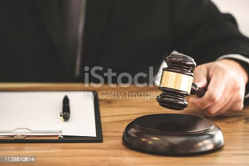 istock Real Estate concept, judge gavel / lawyer in auction with house model 1129810814