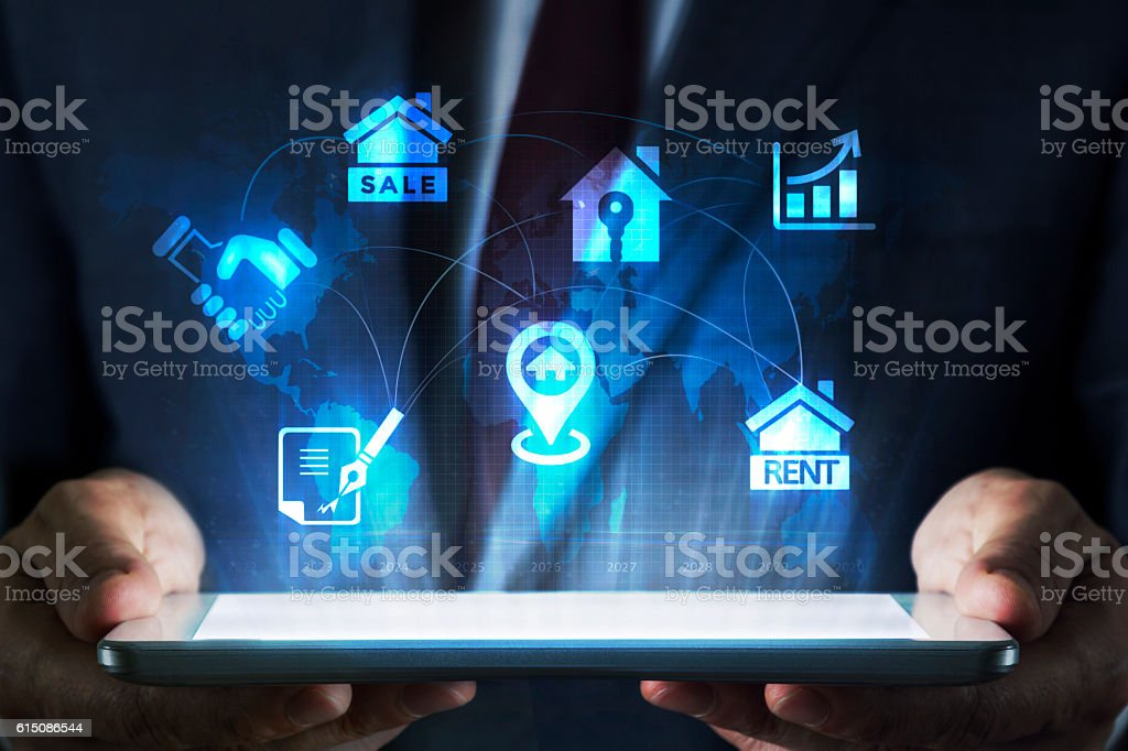 Real estate concept on tablet with hologram stock photo