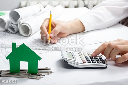 istock Real Estate Concept.  Paper house figure and blank business card 502842422