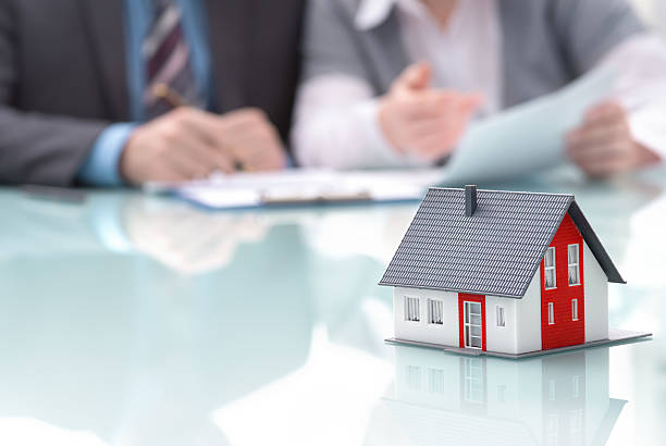Real estate concept Businessman signs contract behind home architectural model  real estate sign stock pictures, royalty-free photos & images