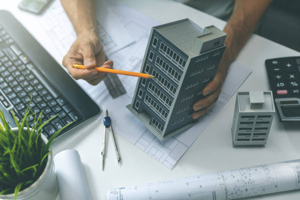 real estate development - construction engineer working on new house project in office - civil engineering stock pictures, royalty-free photos & images