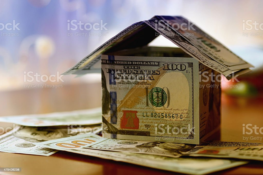 Real Estate dollar house background stock photo
