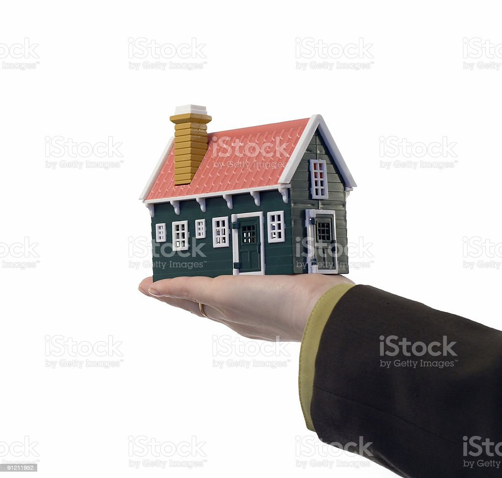 Real estate - house in hand royalty-free stock photo
