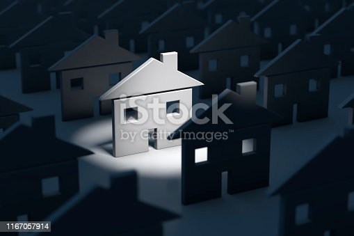 Real estate concept image of standing out of the crowd with one home being illuminated and standing out.