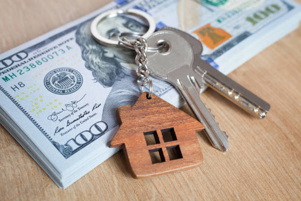 Real estate investing concept. American dollar, cash or housing. Keys close-up Real estate investing concept. American dollar, cash or housing. Keys close-up renting stock pictures, royalty-free photos & images