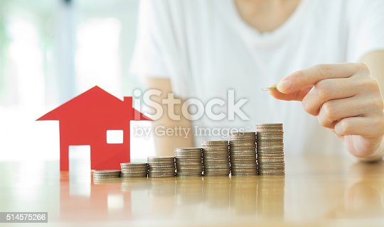 istock Real estate investment. House and coins on table. 514575266