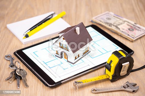Conceptual image of a house being built.