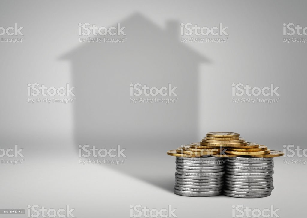 real estate loans concept, money with house shadow stock photo
