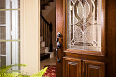 istock Real Estate: Open front door, upscale modern home.  Foyer. 452991149