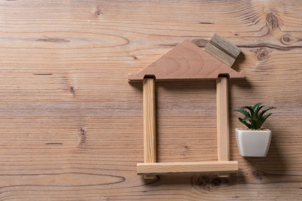 Real estate or property investment. Real estate or property investment. Residential building development.  House models in wooden house frame. Home design and construction concept war effort stock pictures, royalty-free photos & images