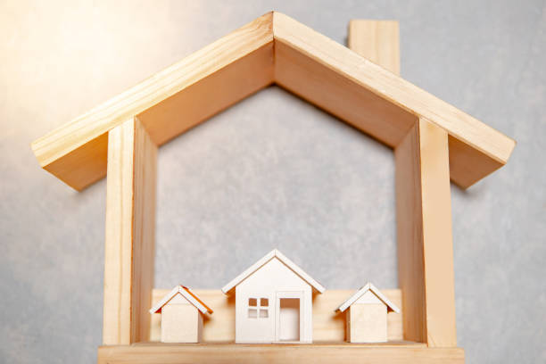 Real estate or property investment. Residential building development. Group of house models in wooden house frame. Home design and construction concept Real estate or property investment. Residential building development. Group of house models in wooden house frame. Home design and construction concept war effort stock pictures, royalty-free photos & images
