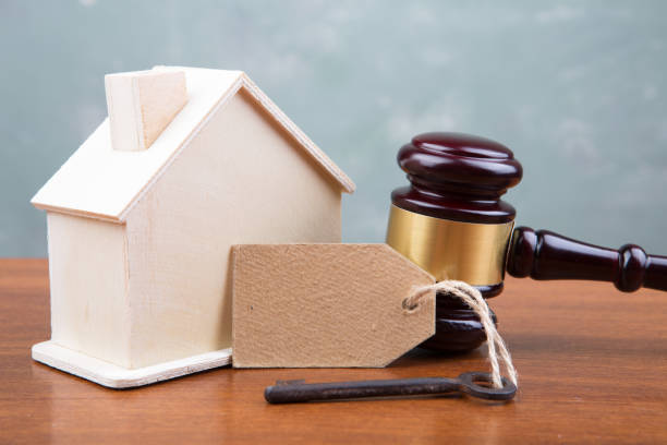real estate sale auction concept - gavel and house model on the wooden table - real estate law stock photos and pictures