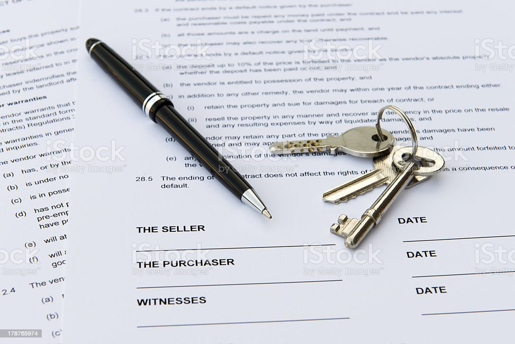 Real estate sales contract with keys and pen stock photo