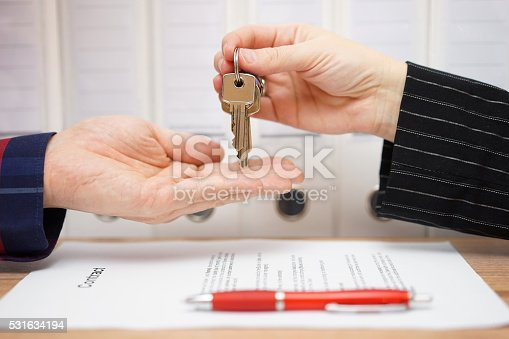 481337750istockphoto real estate seller is giving keys to buyer after signed 531634194