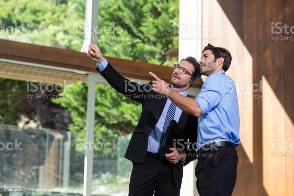 Real estate showing property to a man stock photo