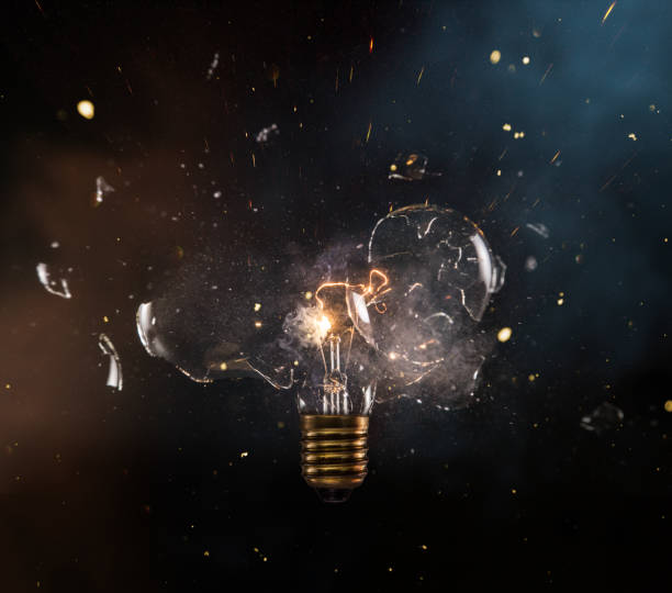 Real explosion of vintage electric bulb. real explosion of vintage electric bulb, close-up.real explosion of vintage electric bulb, close-up. slow motion stock pictures, royalty-free photos & images