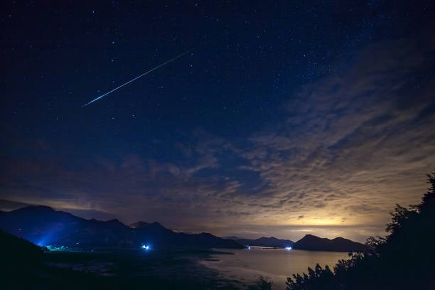 real falling stars with darkness sky a the sunset - shooting stars stock photos and pictures