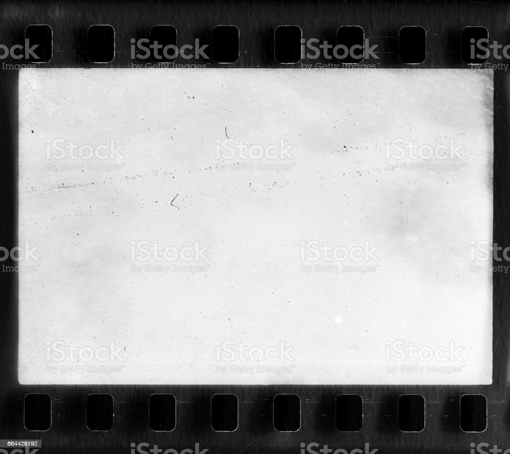 Real film frame with dust and scratches stock photo